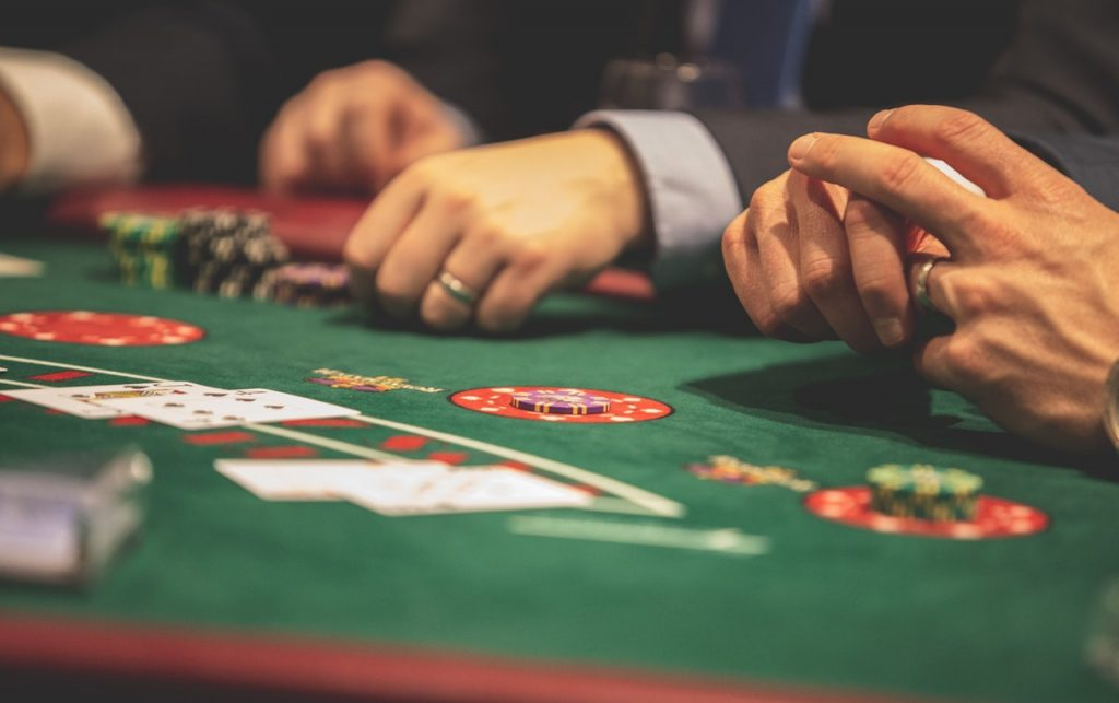 Gamification in apps can strongly influence usage. In it's pure sense, gamification can be used as a core social media app marketing tool. Image Source: https://www.pexels.com/photo/person-playing-poker-1871508/